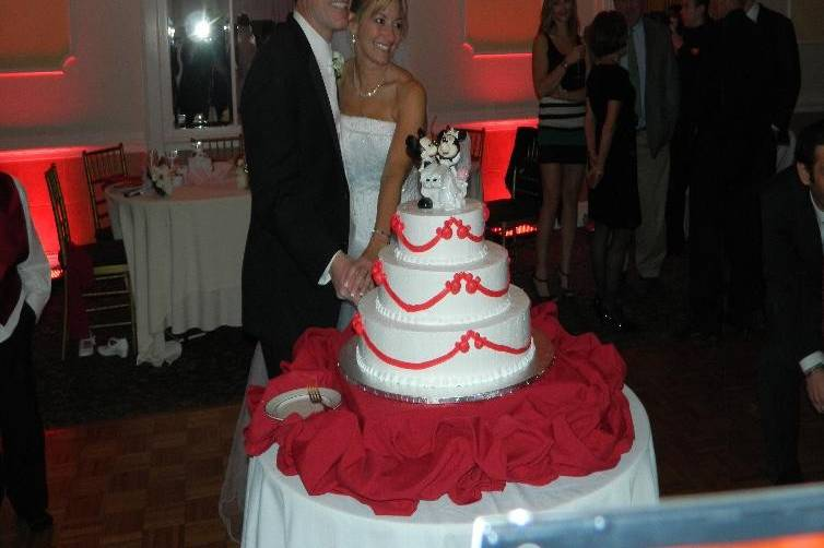 Newlyweds by their cake