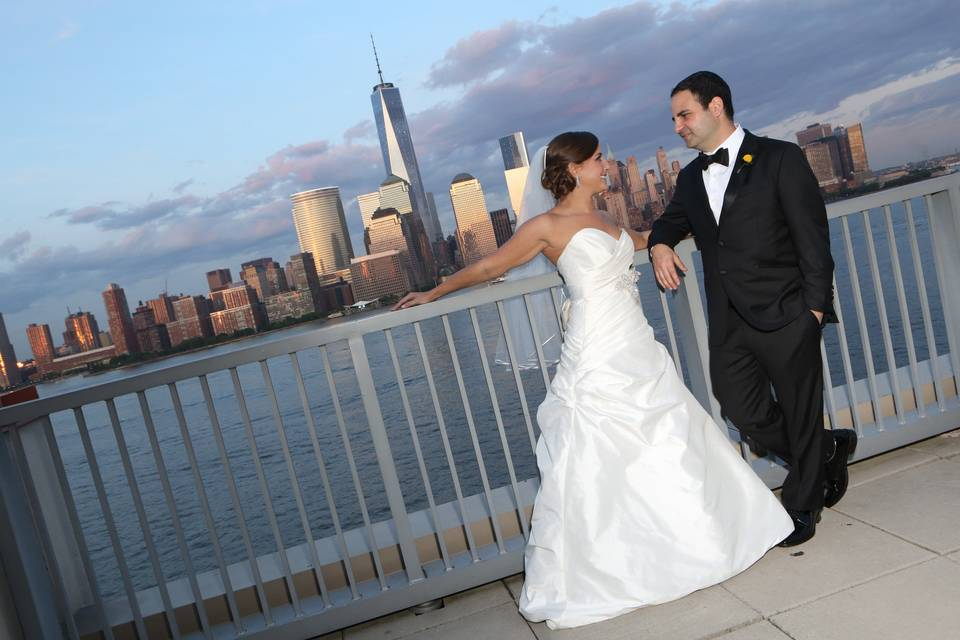 Newlyweds by the city scape
