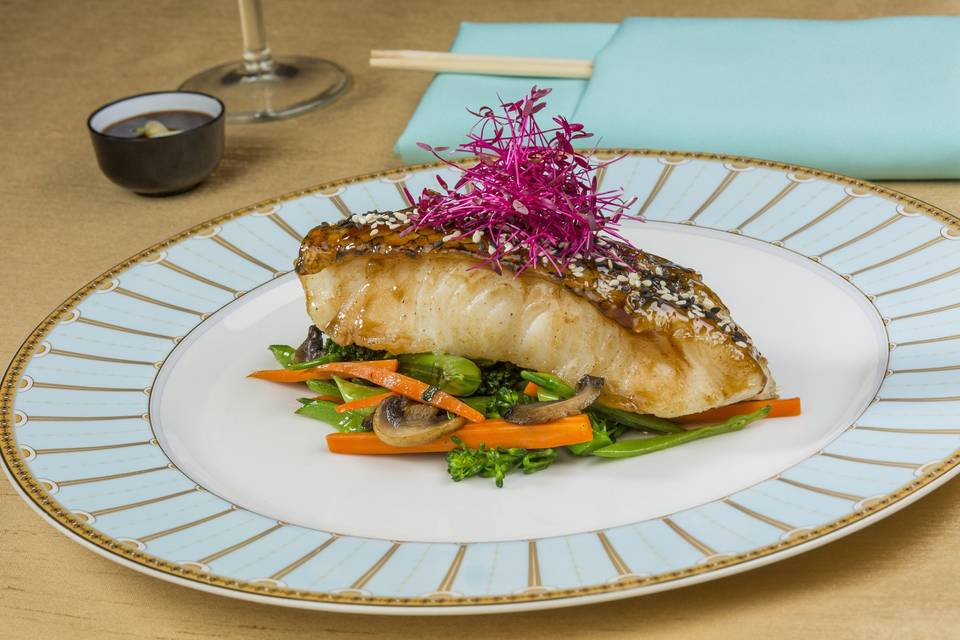 Black and white sesame-crusted szechuan glazed seabass with micro beets and stir-fried asian vegetables