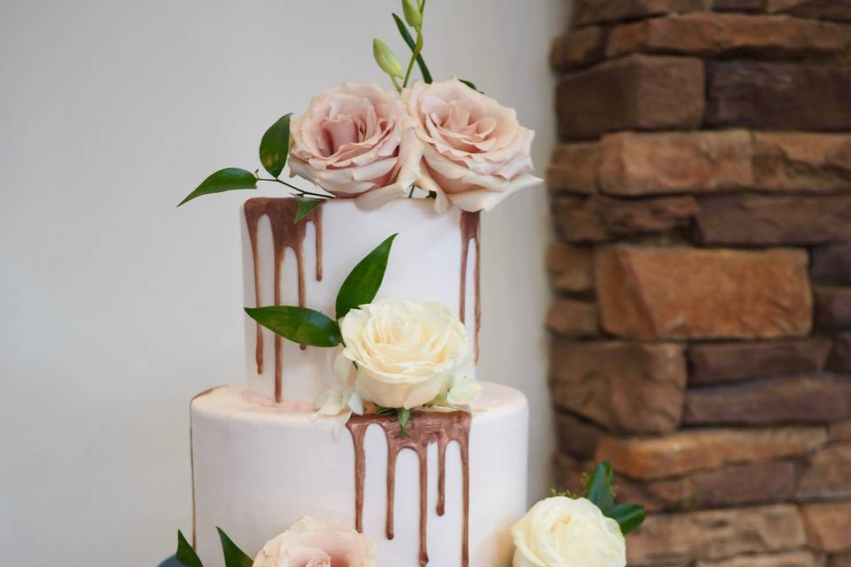 Rose gold drip and navy cake