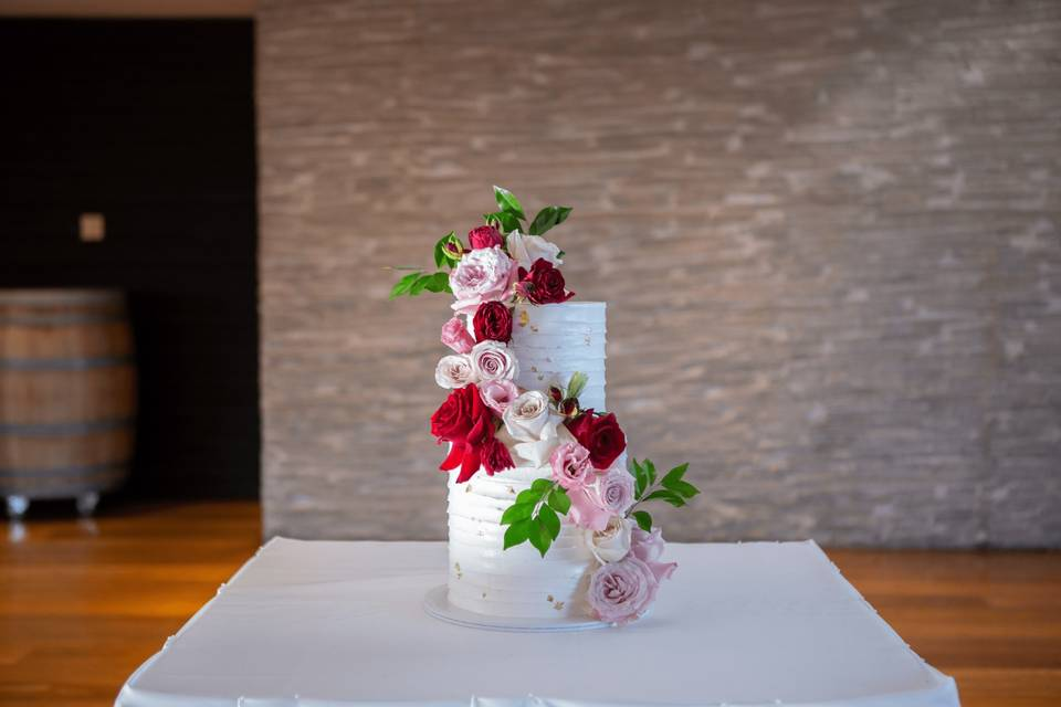 Buttercream cake with floral embellishments