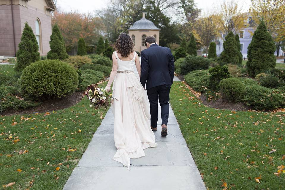 Bride and groom walking along the path