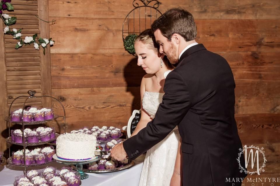 A couple, cutting cake