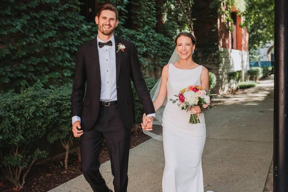 Happy bride and groom walking